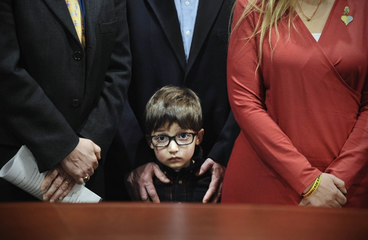 Hayden Lewis, of Norwalk, Conn., cousin of Sandy Hook School shooting victim Jesse Lewis, stands with family during a news conference at the Legislative Office Building, Monday, April 13, 2015, in Hartford, Conn. Connecticut's congressional delegation is backing federal legislation that would honor Lewis and provide expanded support to train teachers in social and emotional learning. (AP Photo/Jessica Hill)