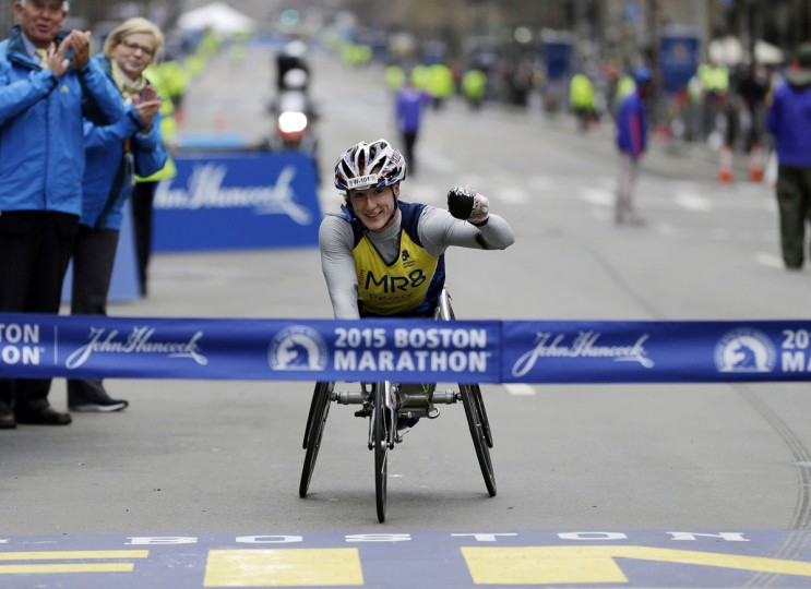 Tatyana McFadden, of Russia, crosses the finish line to win the women's wheelchair division of the Boston Marathon, Monday, April 20, 2015, in Boston. (AP Photo/Elise Amendola)