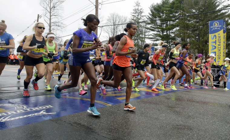 Runners cross the start line in the women's division of Boston Marathon Monday, April 20, 2015 in Hopkinton, Mass. (AP Photo/Stephan Savoia)