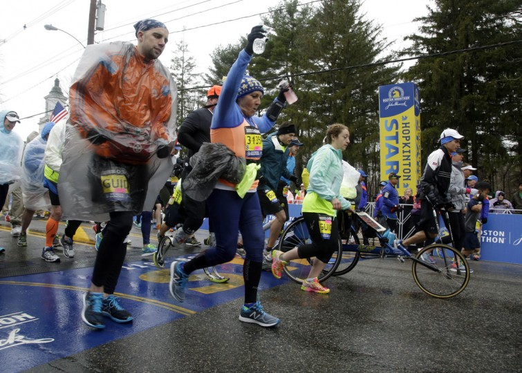 Participants in the Boston Marathon mobility impaired division cross the start line Monday, April 20, 2015 in Hopkinton, Mass. (AP Photo/Stephan Savoia)