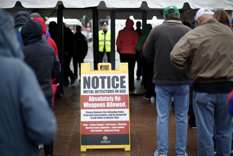 Spectators pass through a security checkpoint near the finish line of the Boston Marathon Monday, April 20, 2015 in Boston. (AP Photo/Robert F. Bukaty)