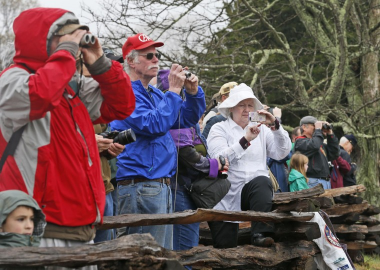 Visitors watch a re-enactment of the Battle of Appomattox Courthouse as part of the commemoration of the 150th anniversary of the surrender of the army of Northern Virginia at Appomattox Court House in Appomattox, Va., Thursday, April 9, 2015. The battle was the final battle of the army of Confederate General Robert E. Lee before his surrender to Union troops. (AP Photo/Steve Helber)