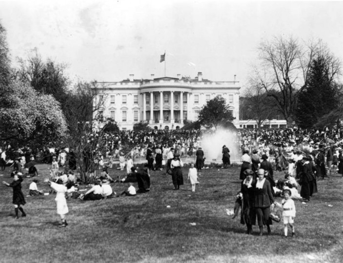 This 1921 photo released by the National Archives shows children Easter egg rolling on the South Lawn of The White House in Washington. World War I and food rationing had put the White House egg roll on hold, scrambling it from 1917-1920. World War II stopped the festivities again from 1943-1945. (AP Photo/Library of Congress)