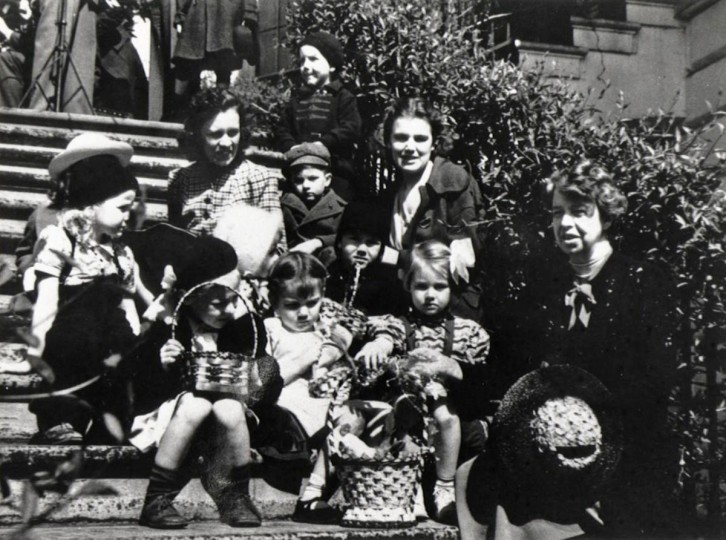 This April 11, 1939, photo released by the National Archives shows first lady Eleanor Roosevelt, right, with children during the Easter egg roll at The White House in Washington. World War I and food rationing put the White House egg roll on hold, scrambling it from 1917-1920. World War II stopped the festivities again from 1943-1945. (AP Photo/Library of Congress)