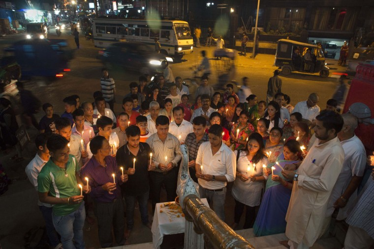 Nepalese people living in India's northeastern Assam state light candles and offer prayers for victims of Saturday's earthquake in Gauhati, India, Monday, April 27, 2015. The earthquake was the worst to hit the South Asian nation in more than 80 years. It and was strong enough to be felt all across parts of India, Bangladesh, China's region of Tibet and Pakistan. (AP Photo/ Anupam Nath)