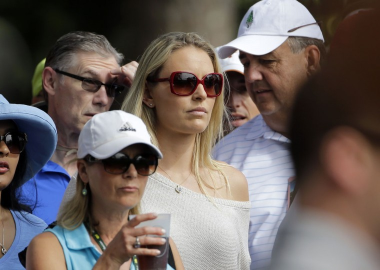 Lindsey Vonn watches Tiger Woods during the second round of the Masters golf tournament Friday, April 10, 2015, in Augusta, Ga. (AP Photo/Matt Slocum)