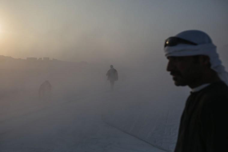 Men work at a limestone quarry at sunrise in the desert of Minya, Egypt. (AP Photo/Mosa'ab Elshamy)