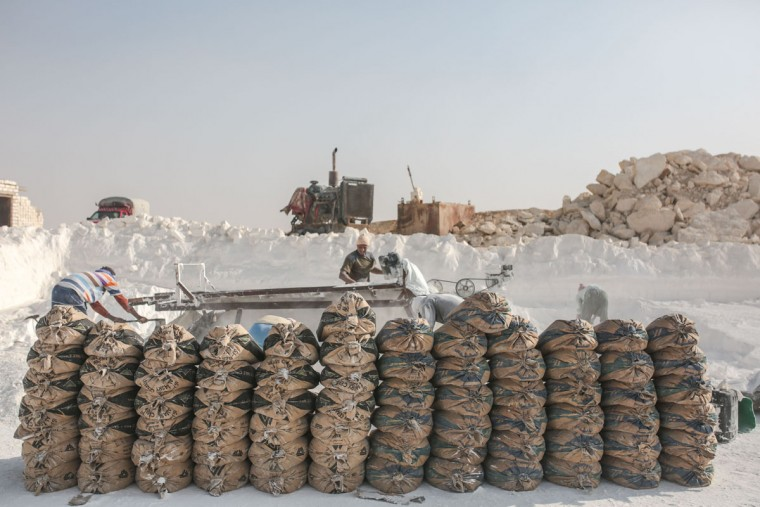 Bags filled with limestone powder are arranged for transport at quarry in the desert of Minya, Egypt. (AP Photo/Mosa'ab Elshamy)
