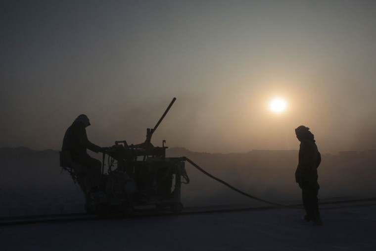 Quarry workers use machinery with sharp rotor blades to cut through limestone pits in the desert of Minya, southern Egypt. Quarry work is considered one of the most dangerous and deadly jobs in the country, carrying a high risk of amputation, electrocution and various respiratory and skin diseases. (AP Photo/Mosa'ab Elshamy)