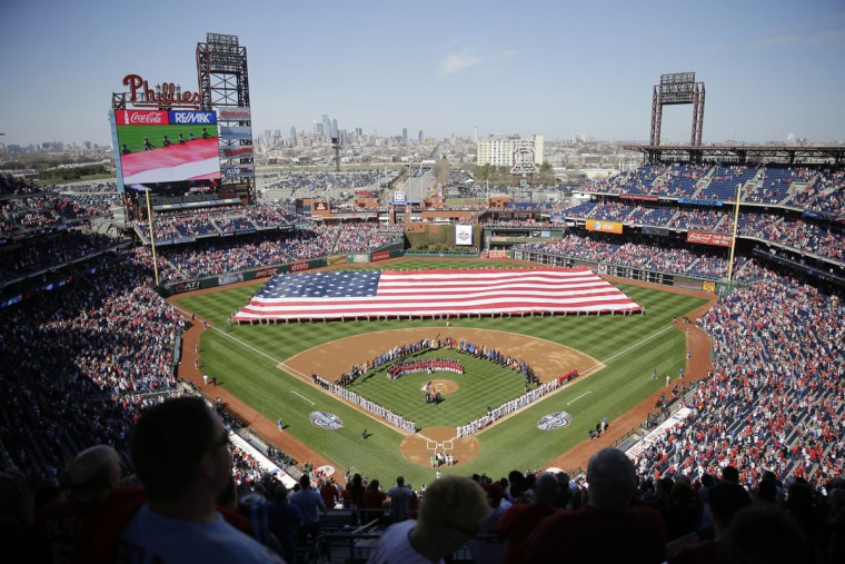 Fans view opening day ceremonies in Philadelphia between the Philadelphia Phillies and the Boston Red Sox on Monday, April 6, 2015. (AP Photo/Matt Rourke)