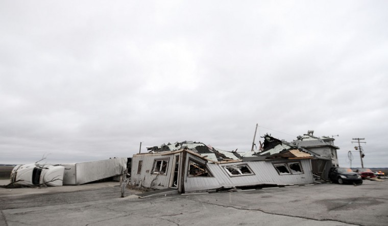 Grubsteaker's restaurant is destroyed after a tornado passed through Thursday night in Rochelle, Ill., Friday, April 10, 2015. Twelve people were trapped in the basement of the restaurant for 90 minutes and were freed unharmed after emergency crews removed debris that had fallen all around. The National Weather Service says at least two tornadoes churned through six north-central Illinois counties. (AP Photo/Daily Herald, Paul Michna)