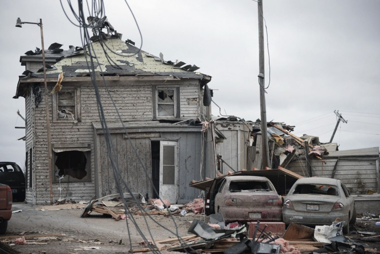 Grubsteaker's restaurant in Rochelle, Ill., is covered with debris Friday morning , April 10, 2015, after being destroyed by a tornado Thursday night. Twelve people were trapped in the basement of the restaurant for 90 minutes. They were freed unharmed after emergency crews removed debris that had fallen all around. (AP Photo/Daily Herald, Paul Michna)