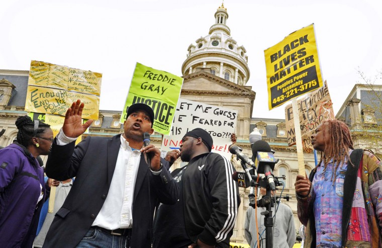 "Edward Brown speaks at a protest outside City Hall about Freddie Gray in Baltimore, Monday, April 20, 2015. Baltimore's top police officials, mayor and prosecutor sought to calm a ""community on edge"" Monday while investigating how Gray suffered a fatal spine injury while under arrest. Six officers have been suspended, but investigators say they still don't know how it happened. (Amy Davis/The Baltimore Sun via AP)"
