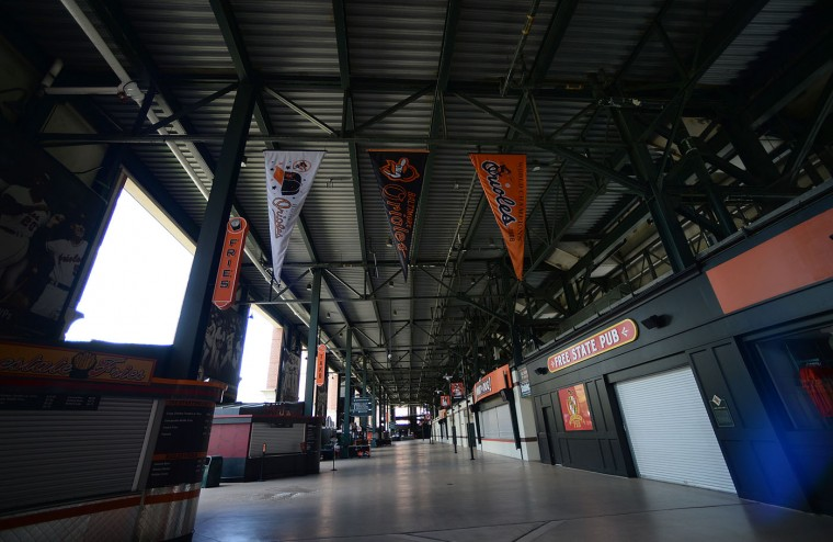 An empty Oriole Park is photographed before the Chicago White Sox and Baltimore Orioles baseball game, Wednesday, April 29, 2015, in Baltimore. Due to security concerns the game was closed to the public. (AP Photo/Gail Burton)