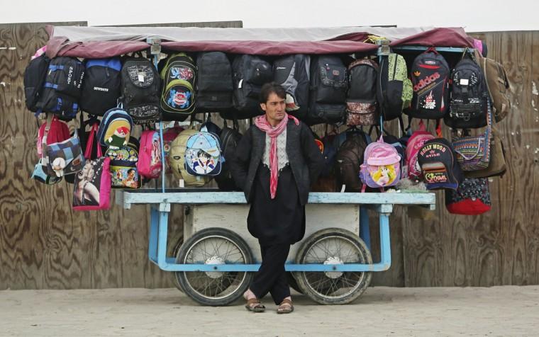 An Afghan vendor waits for customers in the city of Kabul, Afghanistan, Sunday, April 5, 2015. (AP Photo/Rahmat Gul)