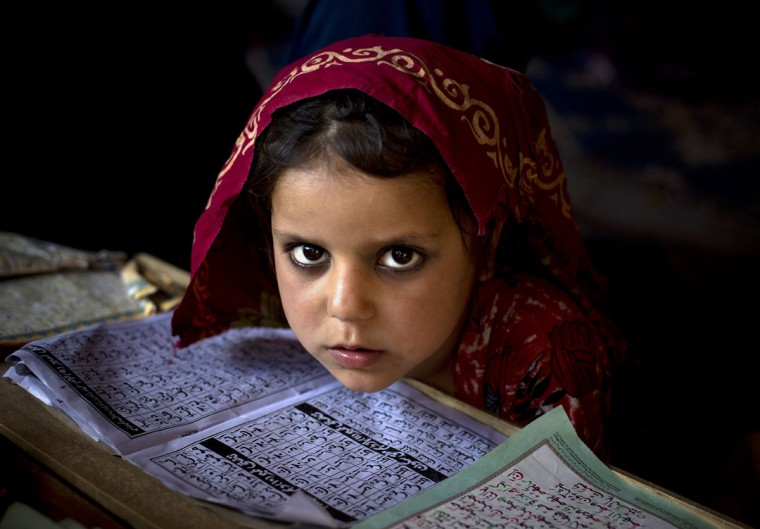 An internally displaced Pakistani girl from a tribal area attends her daily lesson at a madrassa, a school for the study of Islam, on the outskirts of Islamabad, Pakistan, Monday, April 6, 2015. (AP Photo/B.K. Bangash)