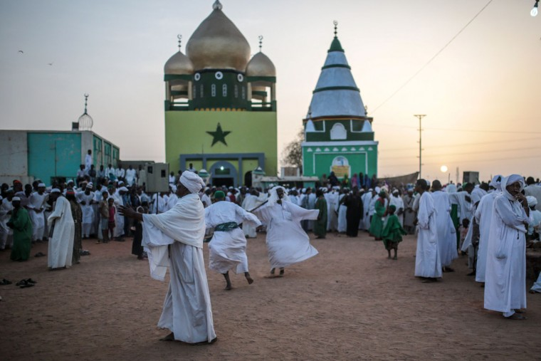 Adherents of the Qadiriyah sufi order attend a weekly gathering at the tomb of Sheikh Hamed Al Nil, a 19th century Sufi leader, where they dance and chant religious hymns until nightfall, in Omdurman, Sudan, Friday, April 10, 2015. (AP Photo/Mosa'ab Elshamy)