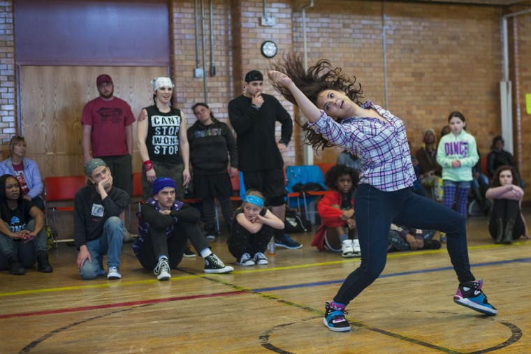 Central Michigan University student Misty Conley, 22, shows of her dance moves during the Berston Banger dance competition at the Berston Fieldhouse, in Flint, Mich. A pool of 32 competitors were cut down to 16 and performed in dance battles. The winner received $300 and the runner-up received $100. (Sam Owens/The Flint Journal-MLive.com via AP)