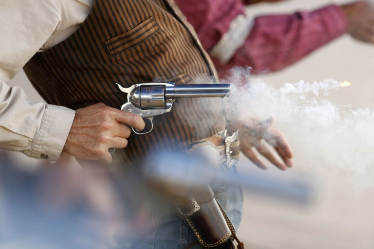 James 'Vic Torious' Robertson from Arkansas competes in the Oklahoma State Gunslinger Championship in Owasso, Okla., on April 18, 2015. (James Gibbard/Tulsa World via AP)
