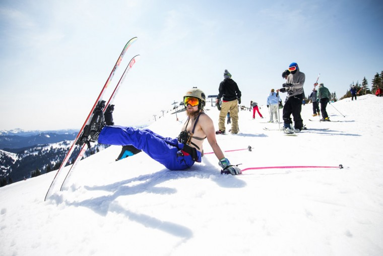 """Jessie Pittis, of North Bend, goes shirtless with his snowsuit. """"I like the powder more, but this will do"""" he said. Skiers and snowboarders reveled in the last official day of the season at Crystal Mountain Resort on Sunday, April 19, 2015 celebrating with the sort of upbeat goofiness that often marks the season's end. (Bettina Hansen/The Seattle Times, via AP)"""