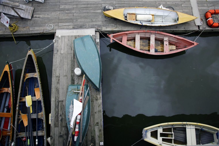 Small boats are gathered at a dock on Fort Point Channel Tuesday, April 21, 2015, in Boston. (AP Photo/Stephan Savoia)