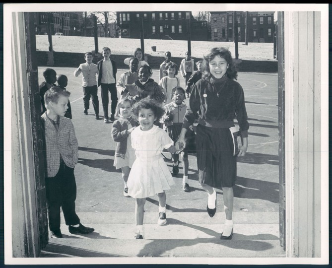 Children entering the school off Fayette. George H. Cook