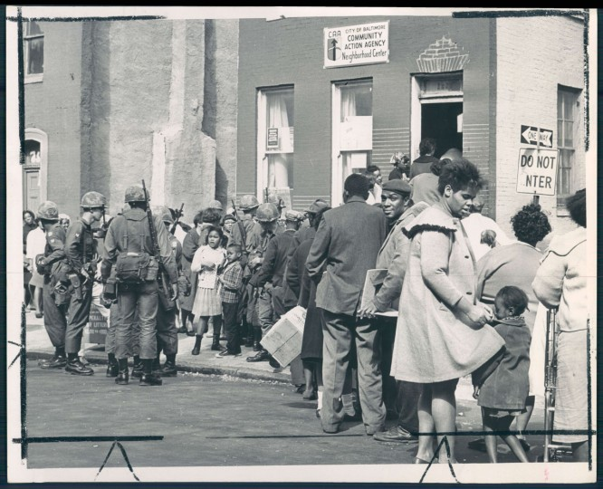 Residents affected by the disorders line up at food depot in the 1900 block of North Bond street.