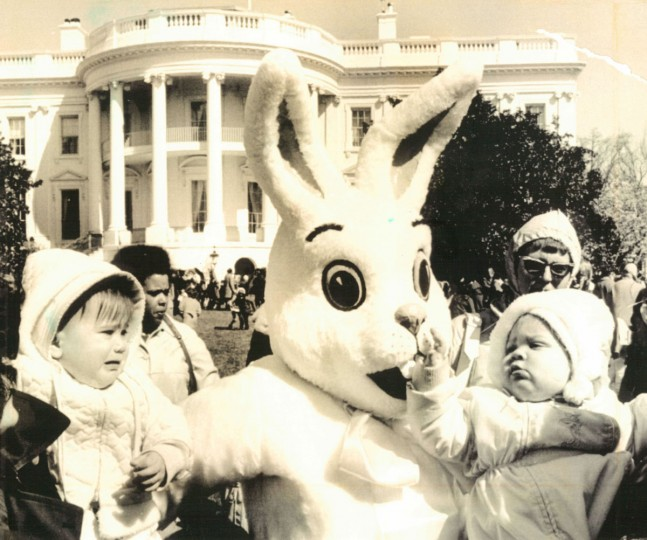 Stephanie Petyak, right, 11 months of Falls Church, Va., appears intrigued while Jennifer Hoffman, left, 13 months of Bowie, Md., appears apprehensive as they meet the Easter Bunny on the lawn of the White House. The occasion was the annual Easter egg roll held at the White House since the day of President Rutherford B. Hayes in 1889. (AP Wirephoto, 1975)