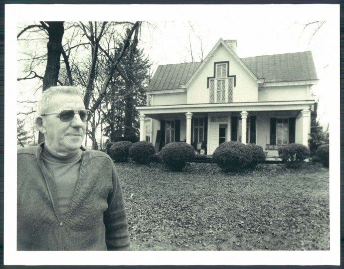Tudor Hall, seen with owner Howard Fox, was the summer home of the Booth family in the 1800s.