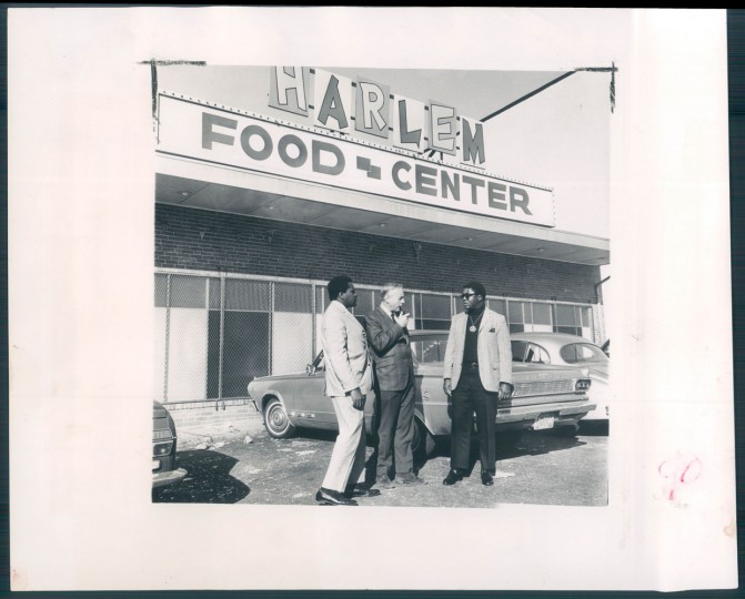 October 28, 1968 - PROTOTYPE MARKET -- A gutted supermarket at the corner of Dolphin Street and Fremont Avenue, closed since last April's riots, has leaped into focus since a proposal by Dr. Daniel Cappon that it be reopened and run by area residents. shown above at the market site are Ross Ford, social worker; Doctor Cappon, University of Maryland, clinical professor of psychiatry and director of the inner-city community health program, and Bob Johnson, director of the Dolphin Street Community Action center. They now seek backing funds. Photo by Ralph L. Robinson.