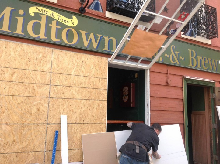 Midtown BBQ & Brew on Centre Street was damaged by rioting last night. (Jeffrey Barker/Baltimore Sun)