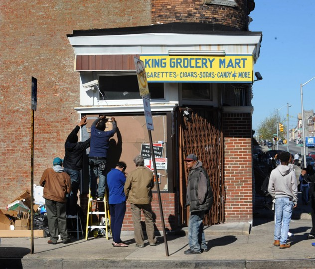 Volunteers help repair damage done to King Grocery Mart at N. Mount and W. North Ave. yesterday during riots sparked by death on April 19 of Freddie Gray while he was in police custody. Yesterday was Gray's funeral. (Algerina Perna/Baltimore Sun)