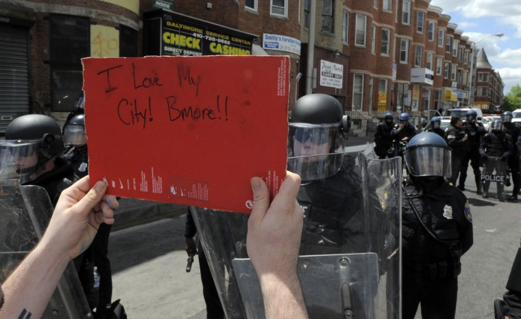 Protesters gather at the intersection of Pennsylvania Avenue and North Avenue Tuesday, a day after riots broke out in Baltimore over the death of Freddie Gray. (Lloyd Fox/Baltimore Sun)