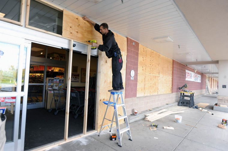 A worker board the Weis grocery store near the Security Square Mall. Police are staged outside the mall. (Kim Hairston/Baltimore Sun)