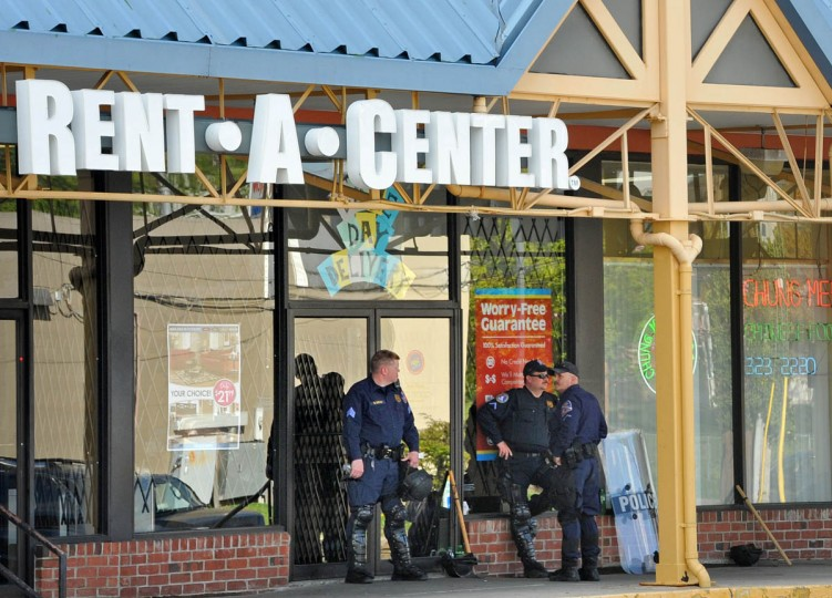 Howard County police were station at the Alameda Marketplace shopping Center in northeast Baltimore, where several stores were looted in In the rioting on Monday. Some stores that had been looted were closed. The riots were sparked by anger to the death of Freddie Gray, who died in police custody on April 19, but the protests provided opportunities for looters. (Amy Davis/ Baltimore Sun)