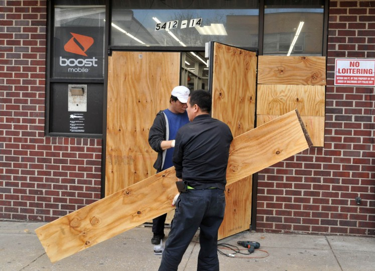 The Boostmobile store at 5412-5414 York Road was one of about five businesses on York Road near Woodbourne Avenue in Govans that was looted on Monday night, as rioting spread in the aftermath of the Freddie Gray protests. (Amy Davis/ Baltimore Sun)