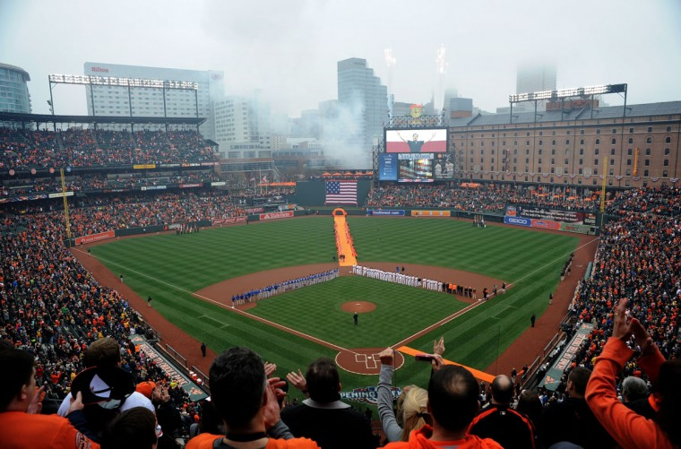 Fans watch pre-game ceremonies before the Orioles' home opener against the Toronto Blue Jays. (Christopher T. Assaf/Baltimore Sun Staff)