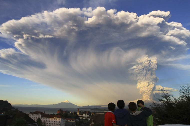 Children watch the Calbuco volcano erupt, from Puerto Varas, Chile. The volcano erupted billowing a huge ash cloud over a sparsely populated, mountainous area in southern Chile. Authorities ordered the evacuation of the inhabitants of the nearby town of Ensenada, along with residents of two smaller communities. (Carlos F. Gutierrez/AP photo)