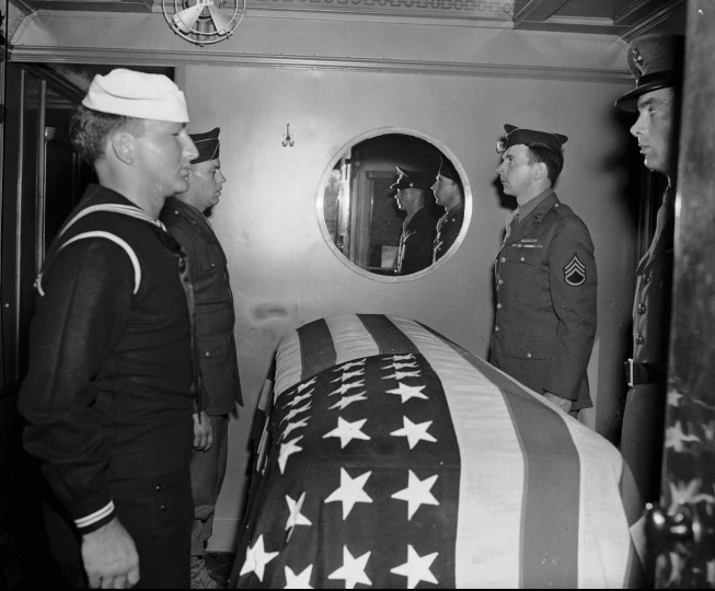 Servicemen stand guard over the casket of President Franklin Delano Roosevelt aboard a train carrying his body from Warm Springs, Ga., to Washington, D.C., on April 13, 1945. The casket was placed in the last car of the funeral train. Roosevelt could not walk unaided across his office, but he led his nation through its worst depression and greatest war. He died at age 63, on April 12, 1945 in his white clapboard cottage in Warm Springs, Ga.