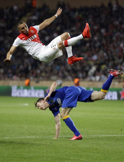 Monaco's Layvin Kurzawa is in the air above /Juventus' Stephan Lichtsteiner during the Champions League quarterfinal second leg soccer match between Monaco and Juventus at Louis II stadium in Monaco. (Michel Euler/AP photo)