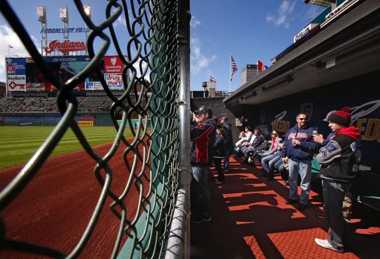 Fans check out the view from the bullpen in the new Right Field District area at Progressive Field before the start of the Cleveland Indians' home opener against the Detroit Tigers on Friday, April 10, 2015, in Cleveland. (Ed Suba Jr./Akron Beacon Journal/TNS)