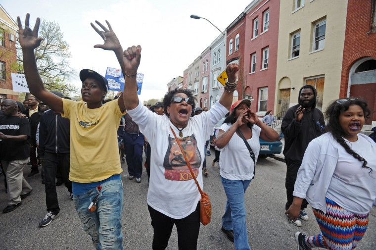 About 600 protestors, including the families of Freddie Gray, protested Gray's death while in the custody of Baltimore police by marching from the site of the arrest to the Western District police station, about six blocks away, on Tuesday, April 21, 2015. (Kenneth K. Lam/Baltimore Sun/TNS)