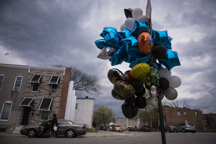 Balloons are tied to a Baltimore stop sign in memory of Freddie Gray. (Washington Post photo by Jabin Botsford)