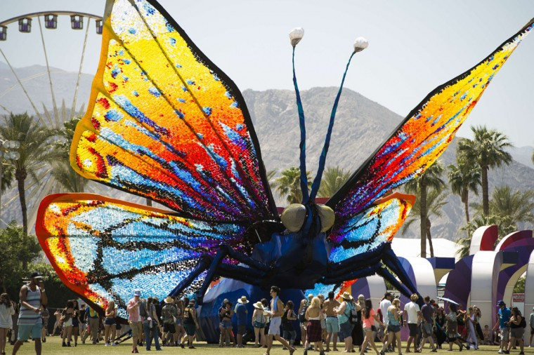 Concert attendees walk past a giant butterfly sculpture on the main grounds on day three of the Coachella Music Festival in Indio, California on April 12, 2015. (ROBYN BECK/AFP/Getty Images)
