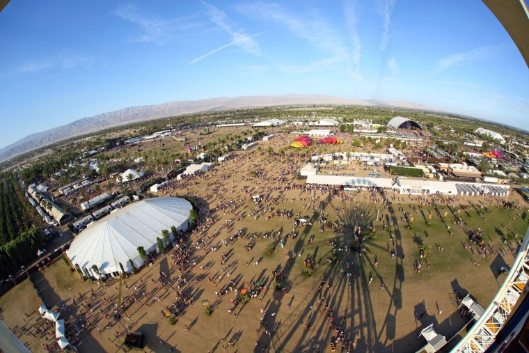 This wide-angle view taken from a Ferris wheel shows activity at the Coachella Music and Arts Festival - Weekend 2, on Sunday, April 19, 2015, in Indio, Calif. (Photo by Zach Cordner/Invision/AP)