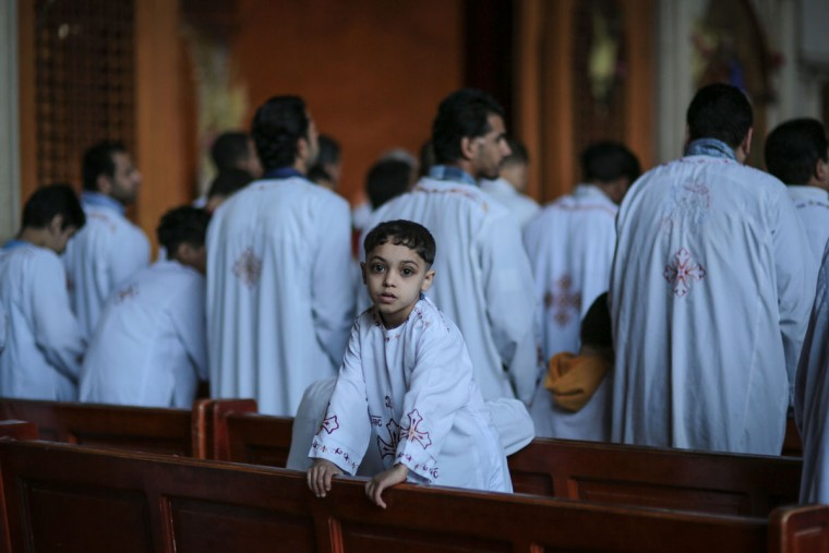 Egyptian Orthodox Christians celebrate Palm Sunday at the Samaan el-Kharaz Church in the Mokattam district of Cairo, Egypt, Sunday, April 5, 2015. For Christians worldwide, Palm Sunday marks Jesus Christ's entrance into Jerusalem, when his followers laid palm branches in his path, prior to his crucifixion. Western Christian churches and most Orthodox Christian churches follow different calendars and observe Easter on different dates. (AP Photo/Mosa'ab Elshamy)