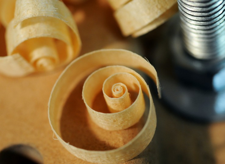Wooden shavings curl up as they are meticulously removed from the back struts. (Jon Sham/BSMG)