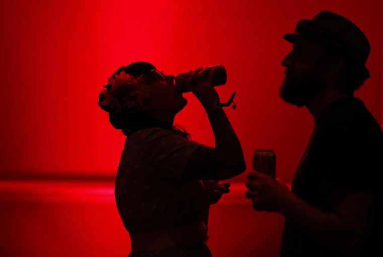 In this April 5, 2015, photo, Rebecca Skehan, left, and Mark Skehan drink beer while listening to live music at the Viva Las Vegas Rockabilly Weekend in Las Vegas. The music was a big draw for the couple, who came from Australia to attend the event. (AP Photo/John Locher)