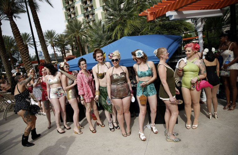 In this April 5, 2015, photo, women wait in line before taking part in a bathing suit contest at the Viva Las Vegas Rockabilly Weekend in Las Vegas. Many of the attendees of the weekend wear vintage clothes. (AP Photo/John Locher)