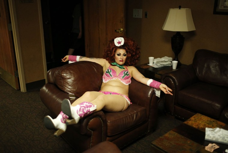 In this April 3, 2015, photo, Susanna Raphael Wellbourne of the burlesque duo Kitten and Lou rests backstage during a burlesque show at the Viva Las Vegas Rockabilly Weekend in Las Vegas. (AP Photo/John Locher)